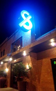 I love the neon sign against the brick building at The Pass & Provisions.